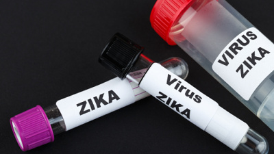 Zika virus concept photo with test tube on black background